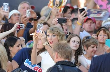 """Caption: Taylor Swift takes a break from the red carpet to take a """"selfy"""" with a fan at the 49th Annual Academy of Country Music Awards at the MGM Grand on the Las Vegas Strip. Sunday, April 6, 2014."""